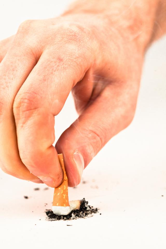 """Hand extinguished a cigarette"" stock image"