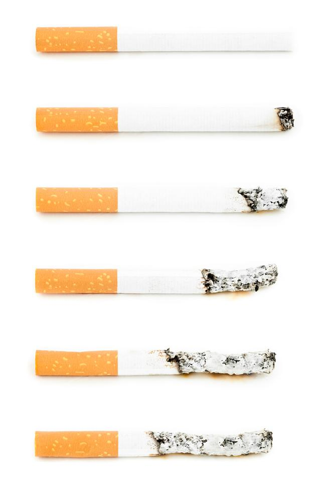 """Different cigarettes burning"" stock image"