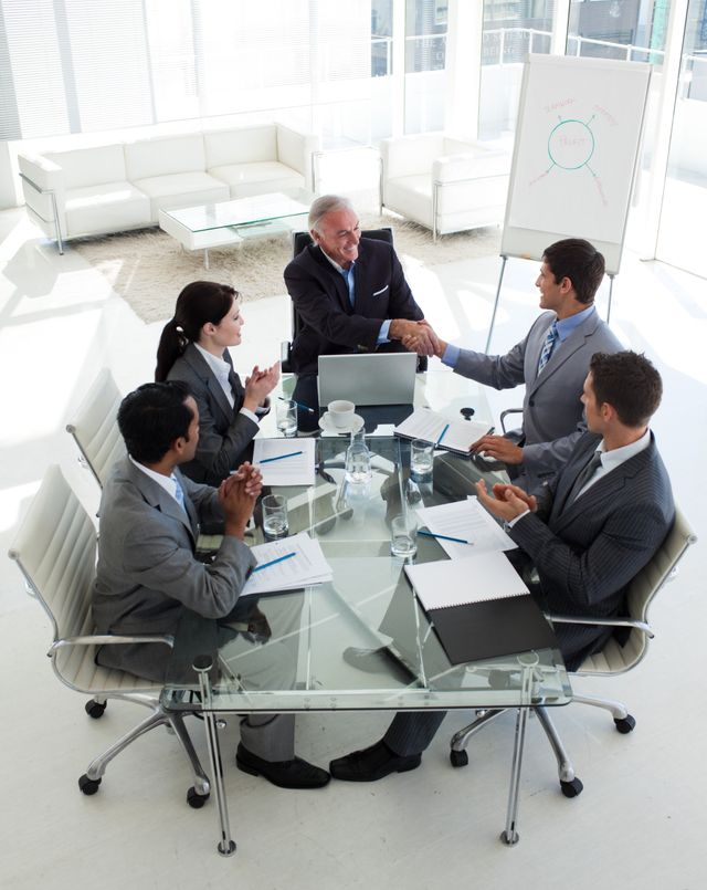 """""""Happy businessman closing a deal at the end on a meeting"""" stock image"""