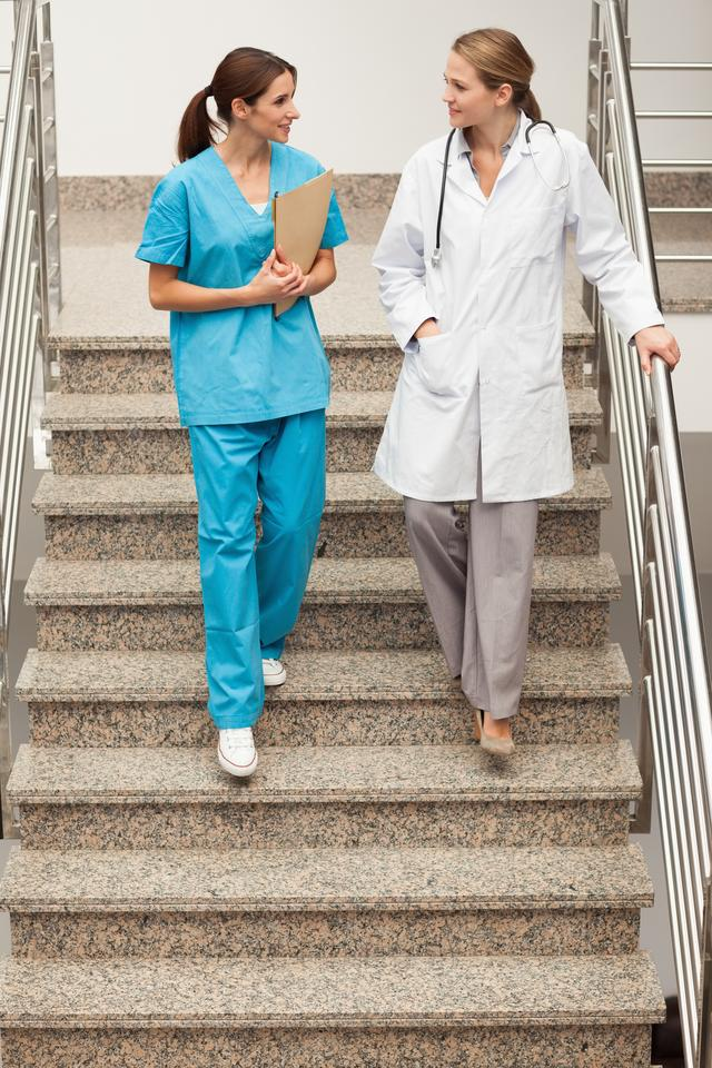 """Health specialists going down the stairs"" stock image"