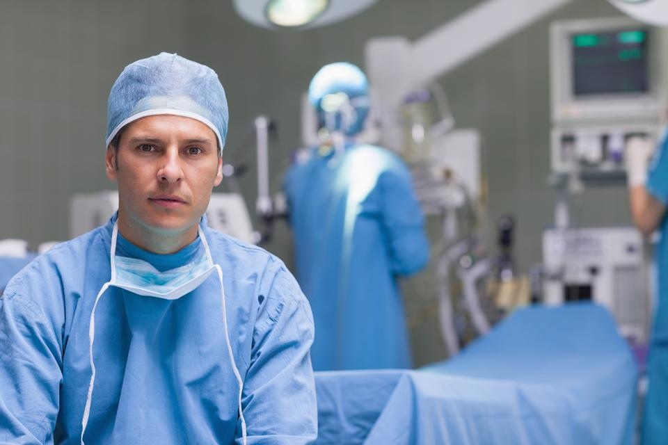 """""""Practitioner next to operating table"""" stock image"""