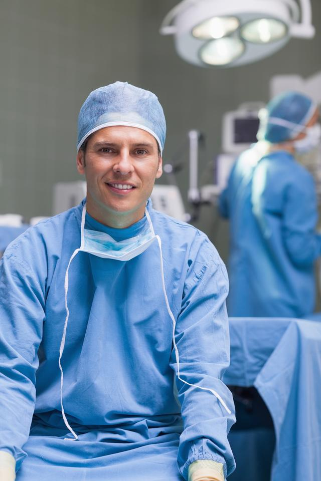 """""""Practitioner wearing a surgical equipment"""" stock image"""