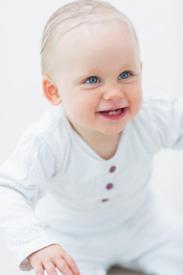 """""""Smiling baby looking up"""" stock image"""