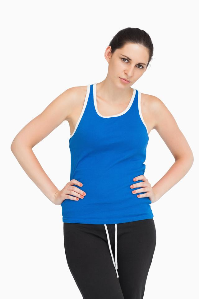 """Serious brunette in sportswear"" stock image"