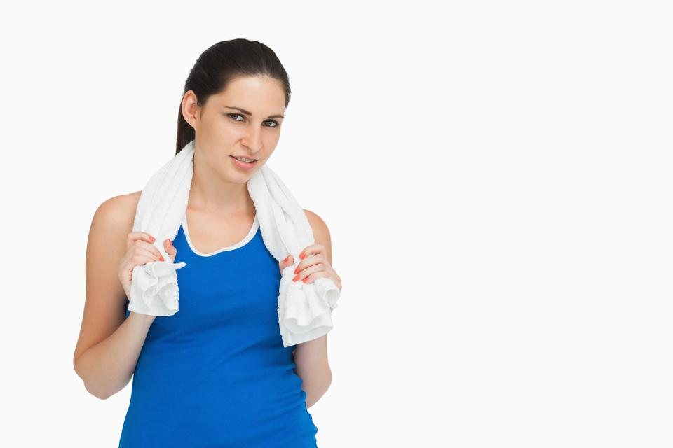 """Brunette in sportswear with a towel"" stock image"