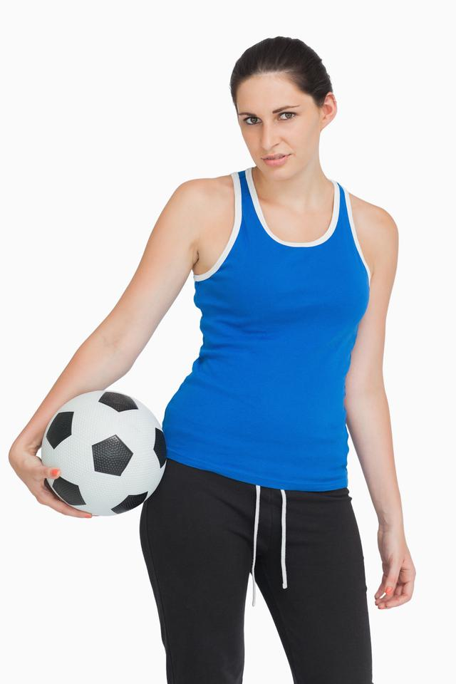 """Sportswoman with a football"" stock image"