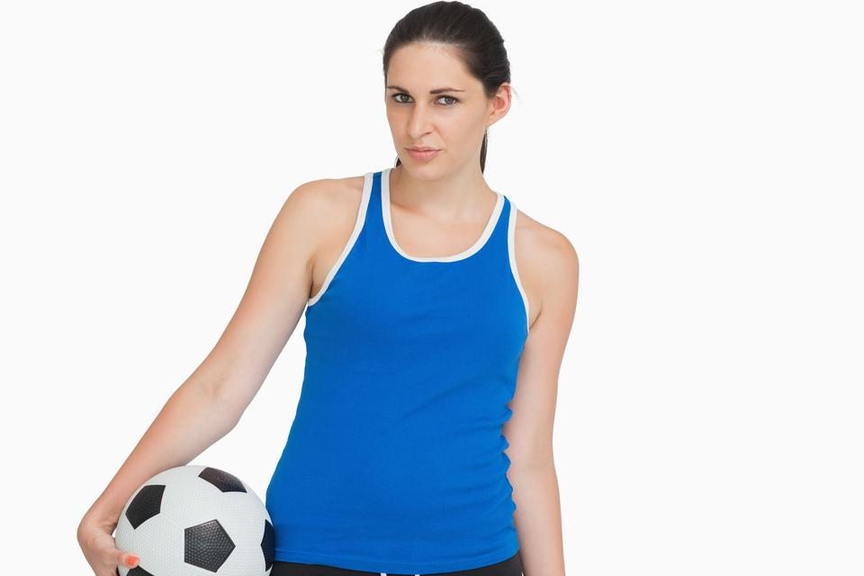 """Serious sportswoman with a soccer ball"" stock image"
