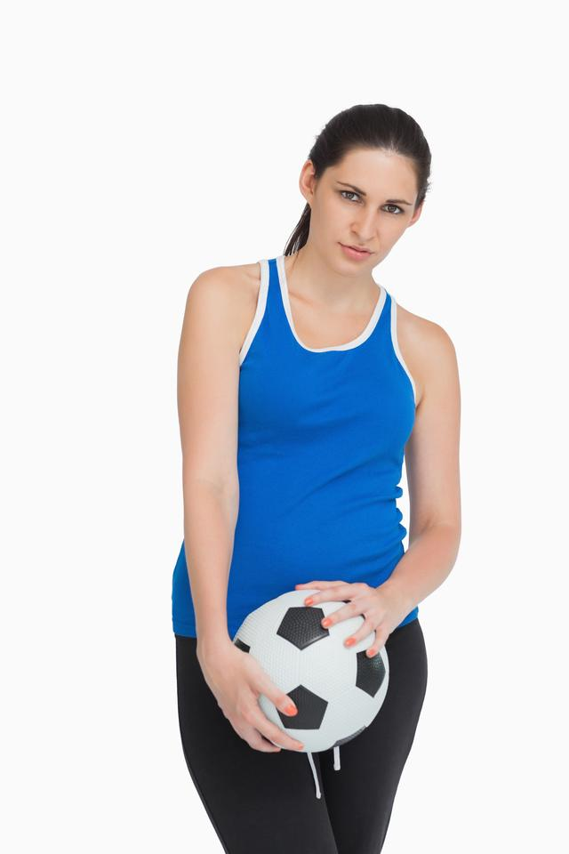 """Sportswoman holding a soccer ball"" stock image"