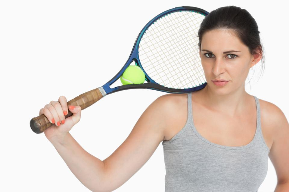 """Sportswoman with a tennis racket"" stock image"