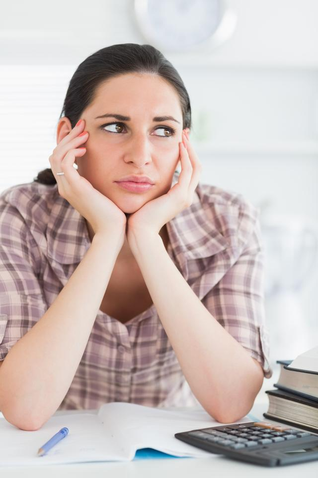 """""""Upset woman with books and calculator"""" stock image"""