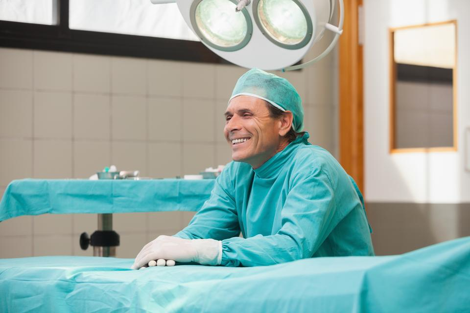 """""""Happy surgeon sitting in operating theatre"""" stock image"""