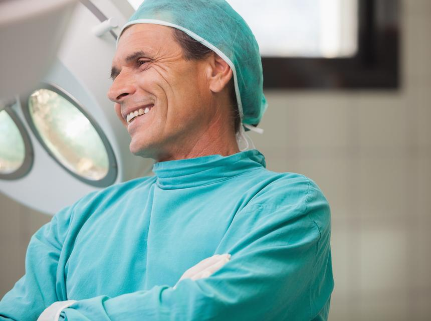 """""""Surgeon smiling with arms crossed"""" stock image"""
