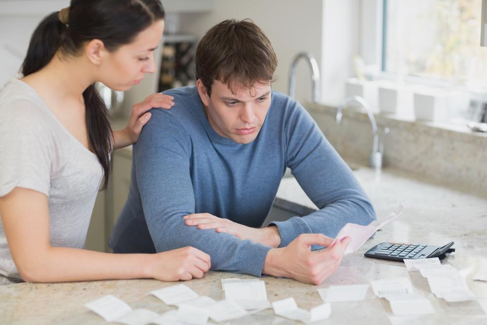 """""""Couple calculating bills in kitchen"""" stock image"""