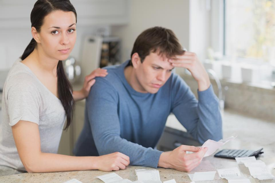 """""""Young couple calculating the finances"""" stock image"""