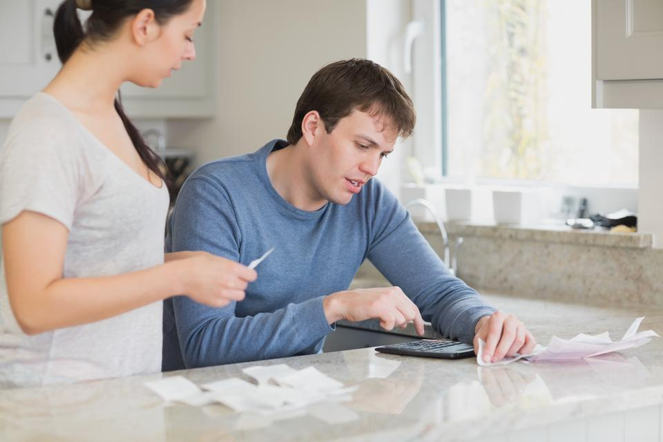 """""""Young couple calculating"""" stock image"""
