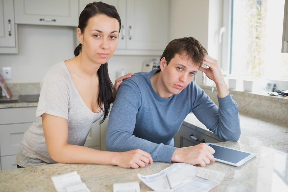 """""""Couple calculating the finances"""" stock image"""