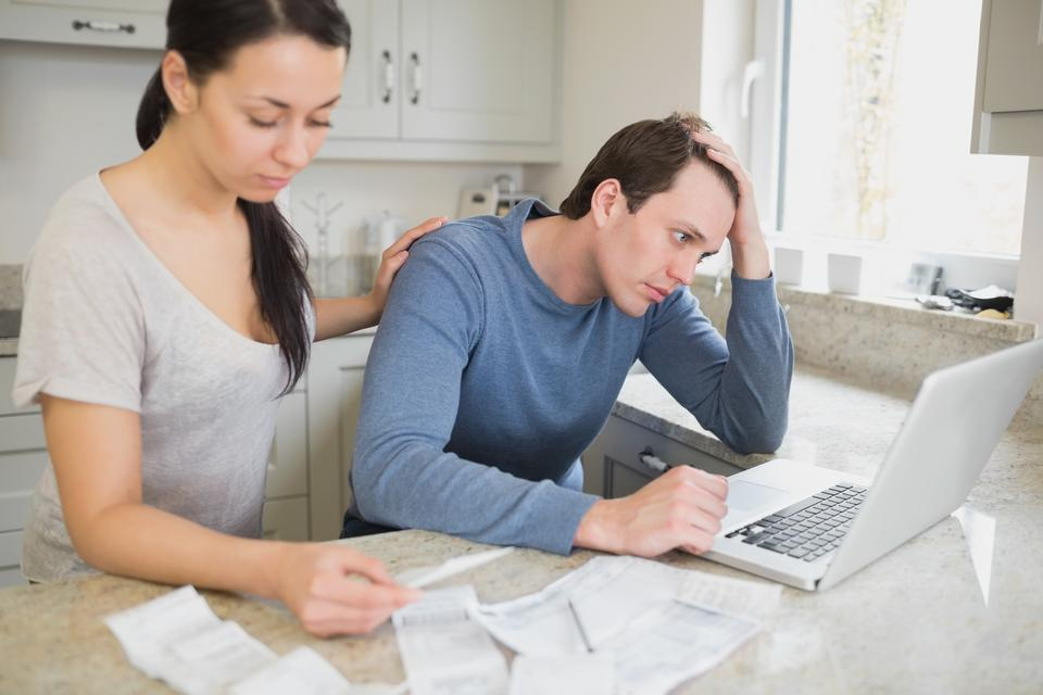 """""""Young couple calculating finances"""" stock image"""