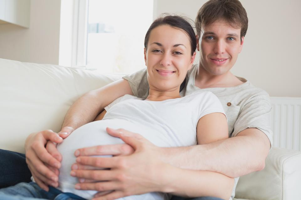 """Young couple expecting a newborn"" stock image"