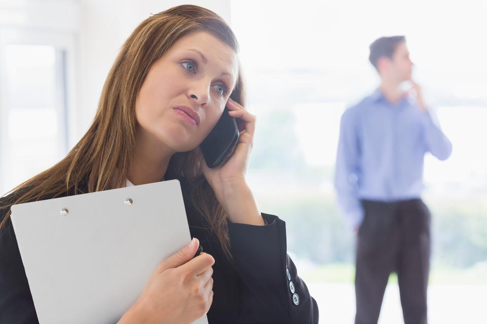 """""""Estate agent looking disappointed on the phone"""" stock image"""