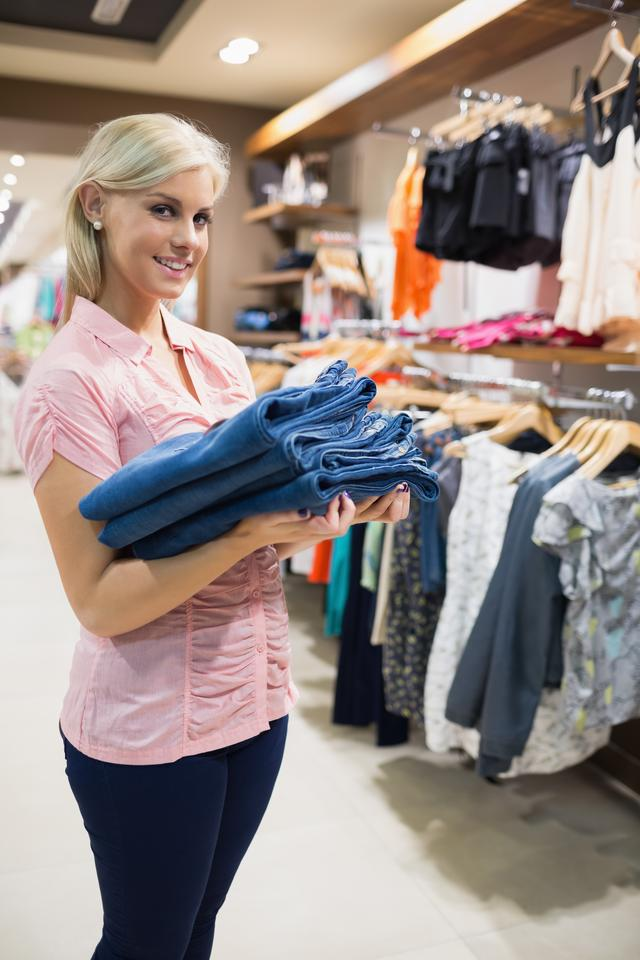 """""""Woman holding pants in her hands"""" stock image"""