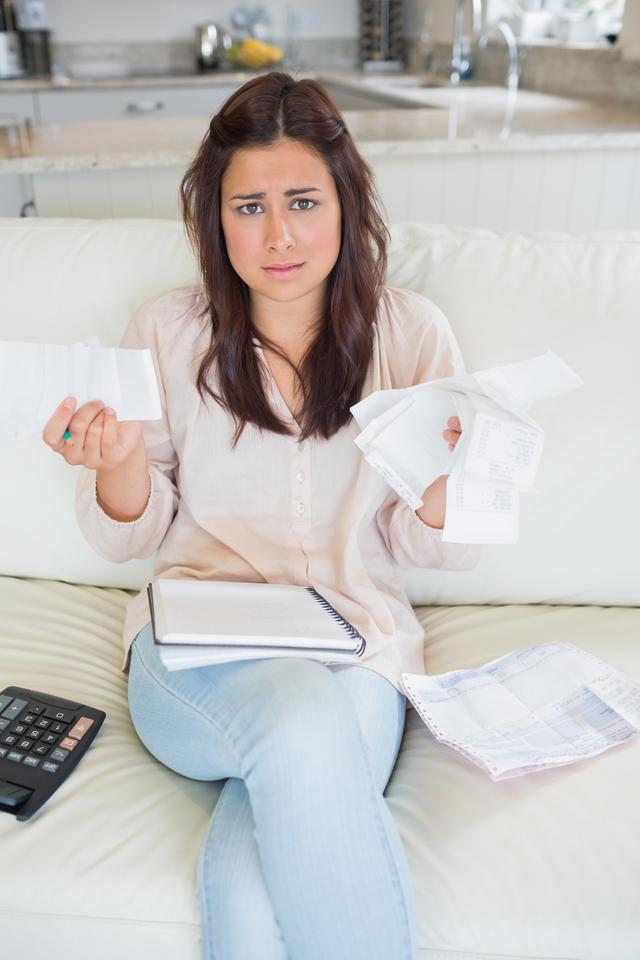 """""""Worried woman calculating finances"""" stock image"""