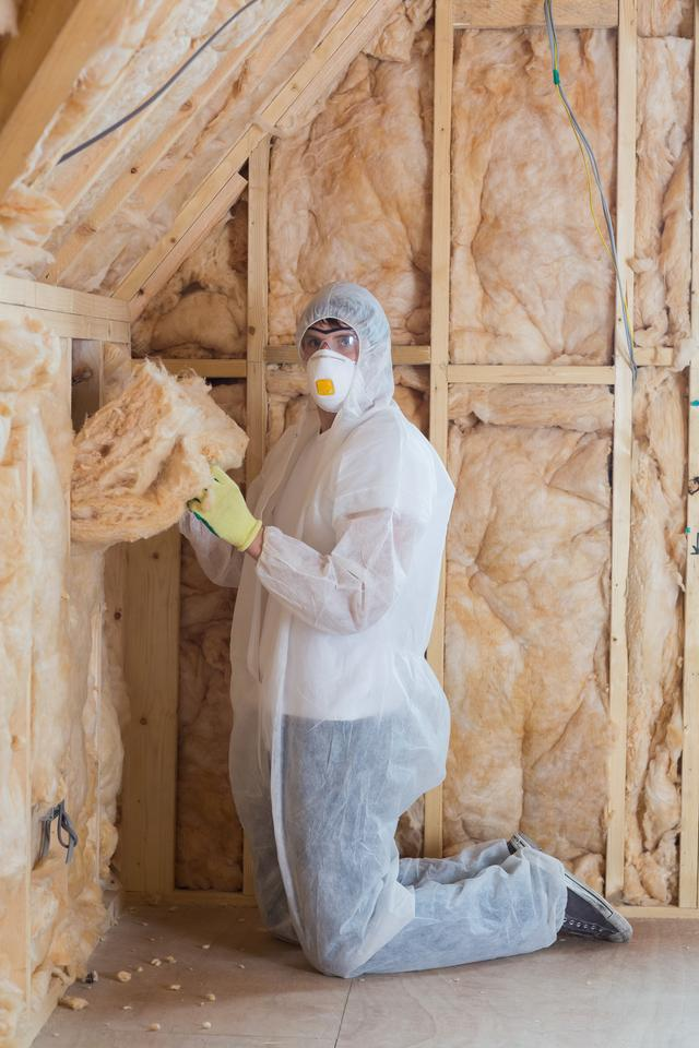 """Worker filling walls with insulation"" stock image"