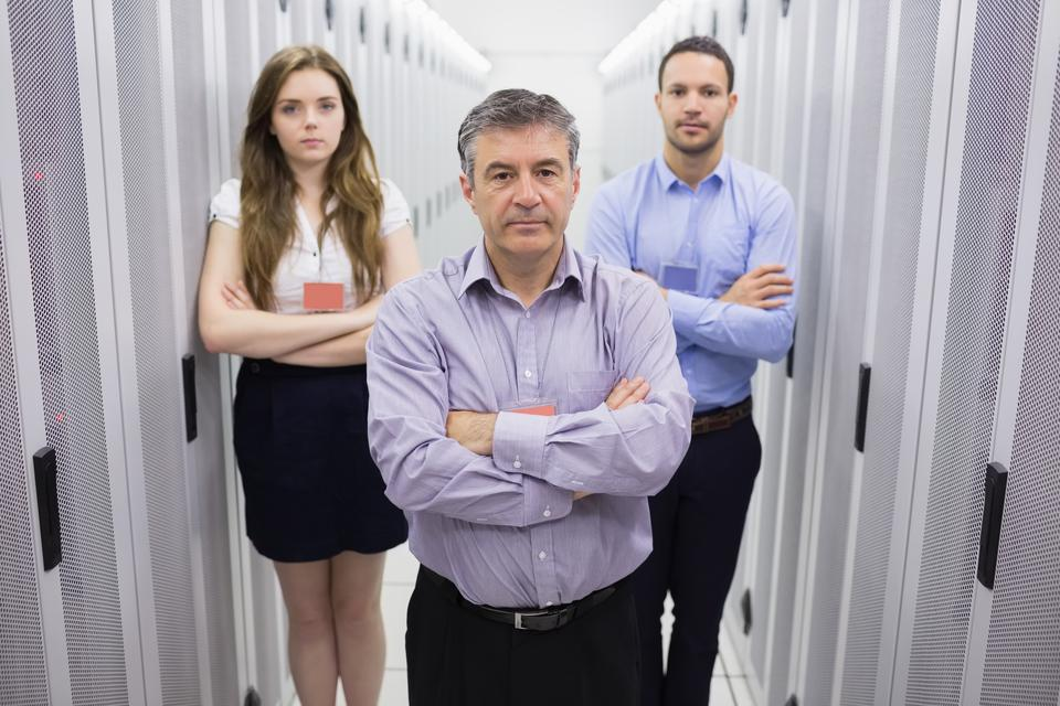 """Three people in data center"" stock image"