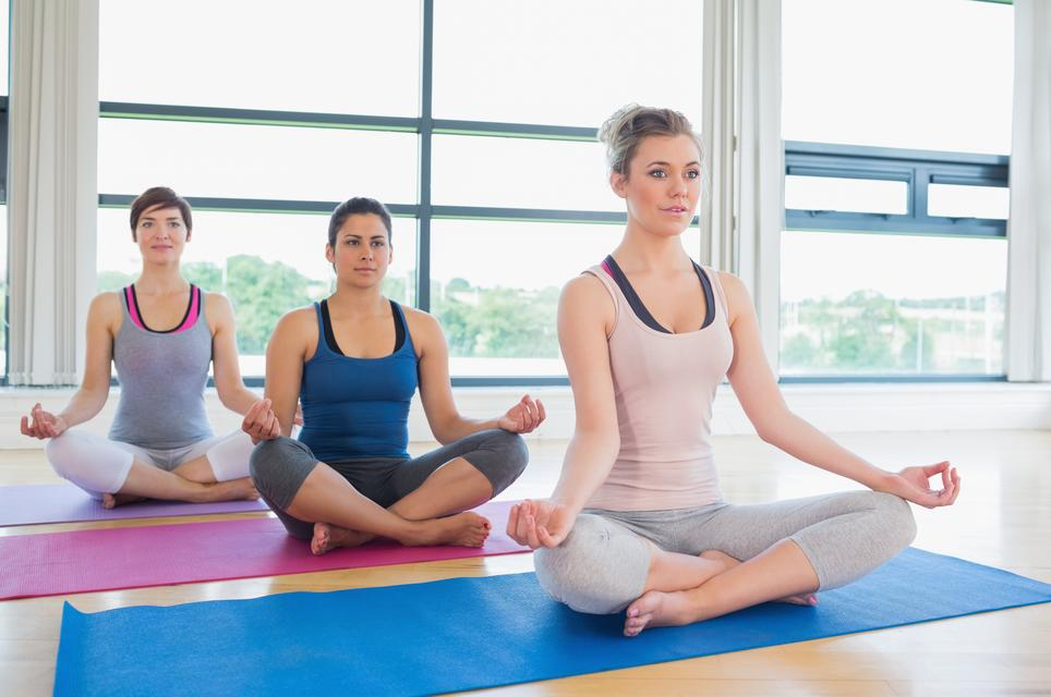"""Women meditating in easy yoga pose"" stock image"