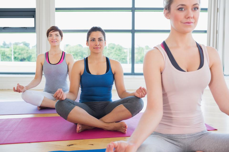 """Women sitting in easy yoga pose"" stock image"