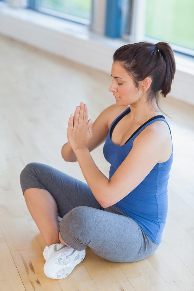 """Woman meditating in easy yoga pose"" stock image"