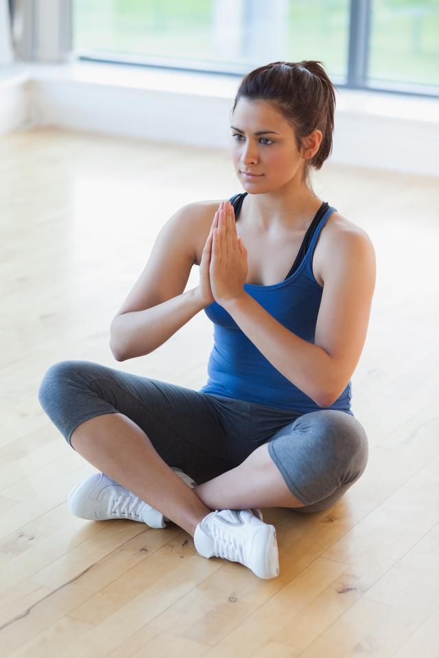 """Woman sitting in easy yoga pose"" stock image"
