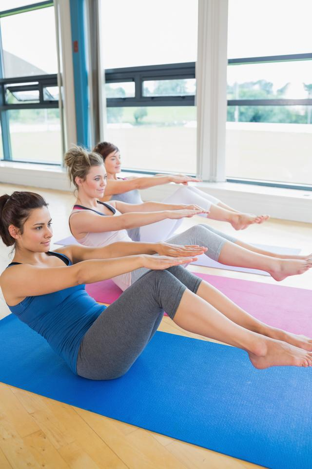 """""""Women in boat pose at yoga class"""" stock image"""