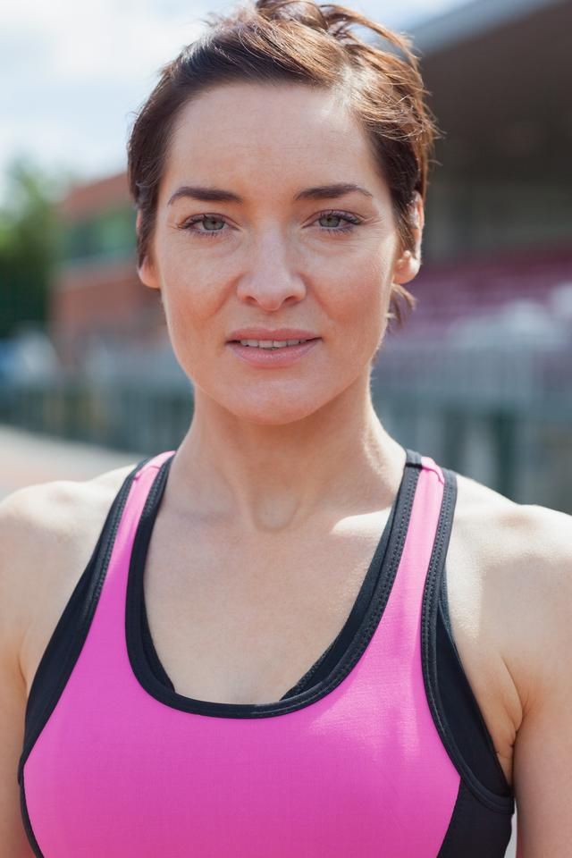 """Woman in pink sportswear"" stock image"