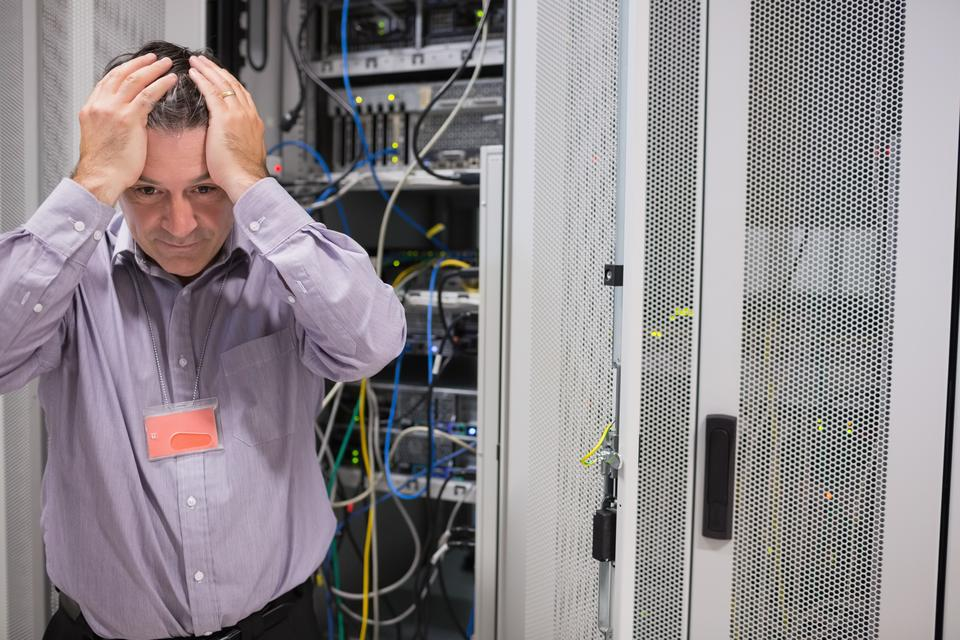 """Man looking weary of data servers"" stock image"