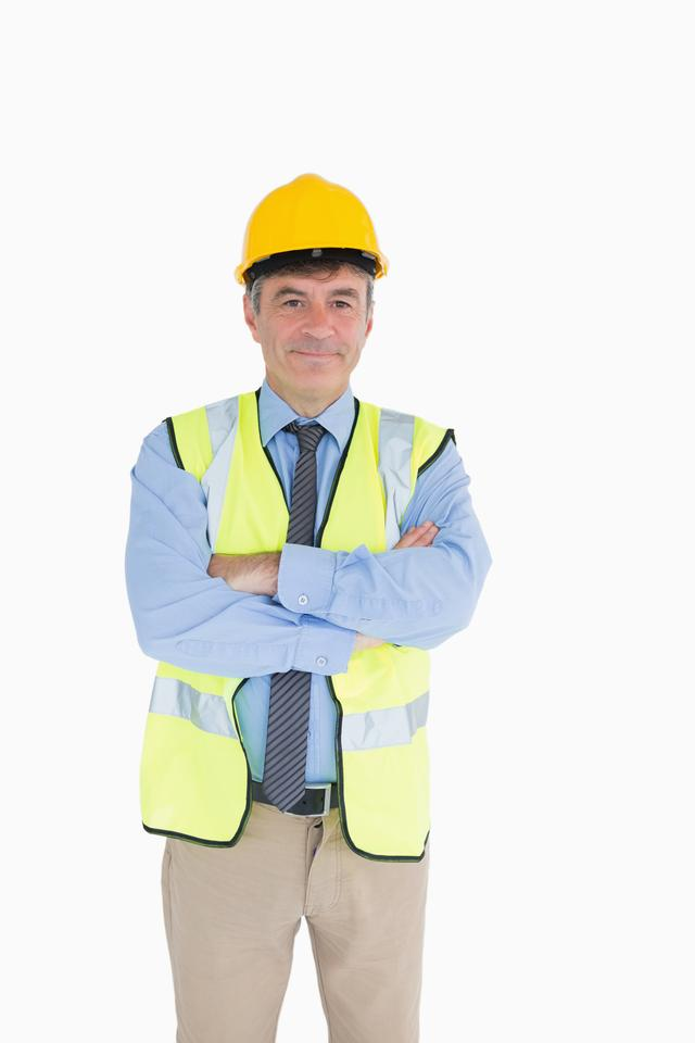 """Man wearing hardhat and vest"" stock image"