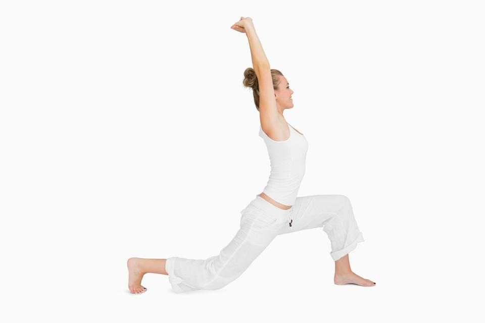 """""""Woman in low lunge yoga pose"""" stock image"""