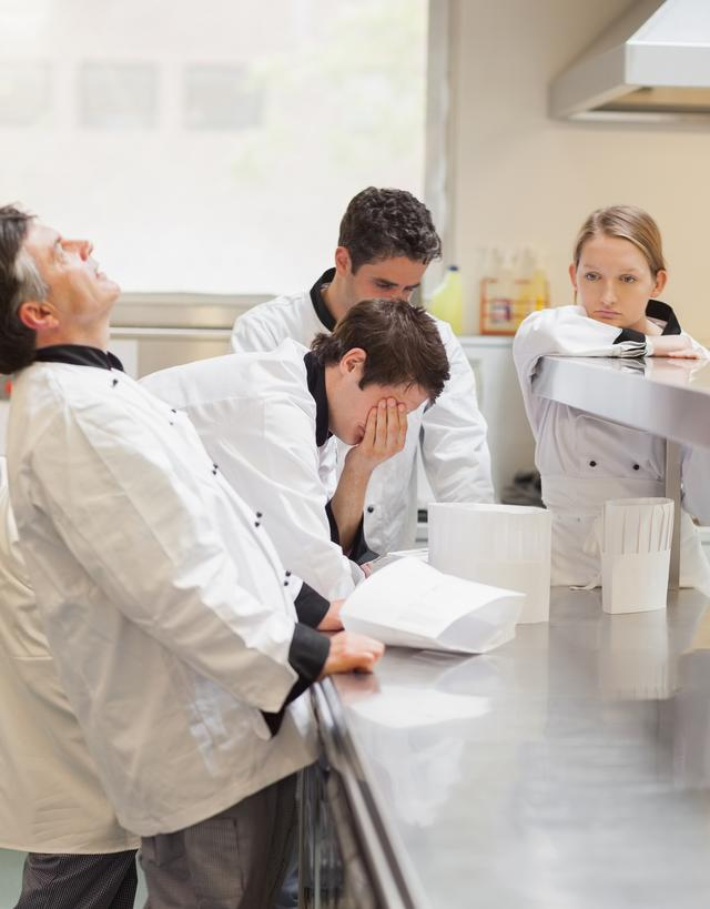 """""""Frustrated Chefs discussing the menu"""" stock image"""