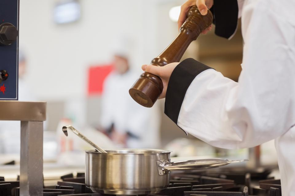 """""""Chef adding pepper to soup"""" stock image"""