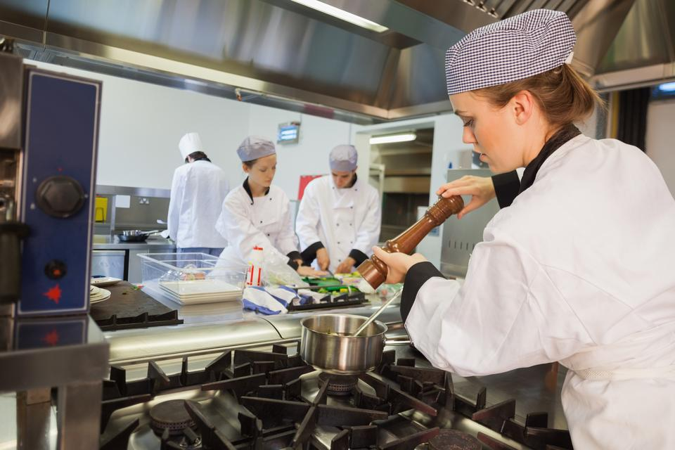 """""""Chef adding pepper to her soup"""" stock image"""