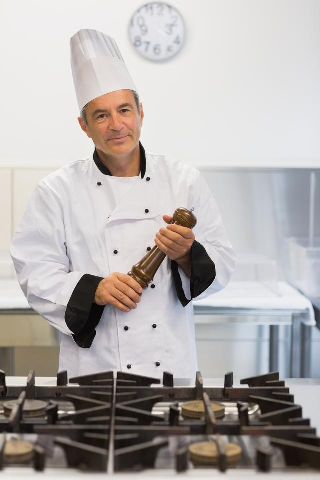 """""""Smiling chef holding a pepper mill"""" stock image"""