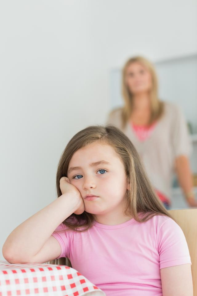 """""""Little girl looking annoyed"""" stock image"""