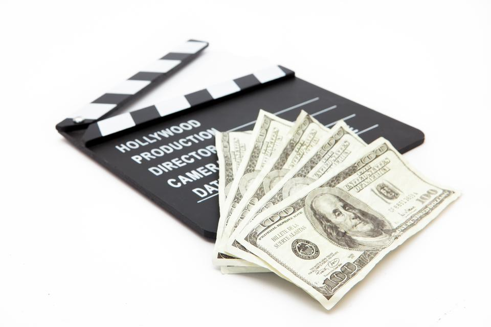 """Film slate and money"" stock image"