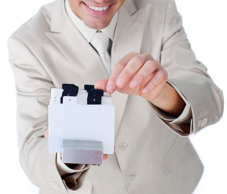 """""""Attractive businessman holding a book at the camera"""" stock image"""