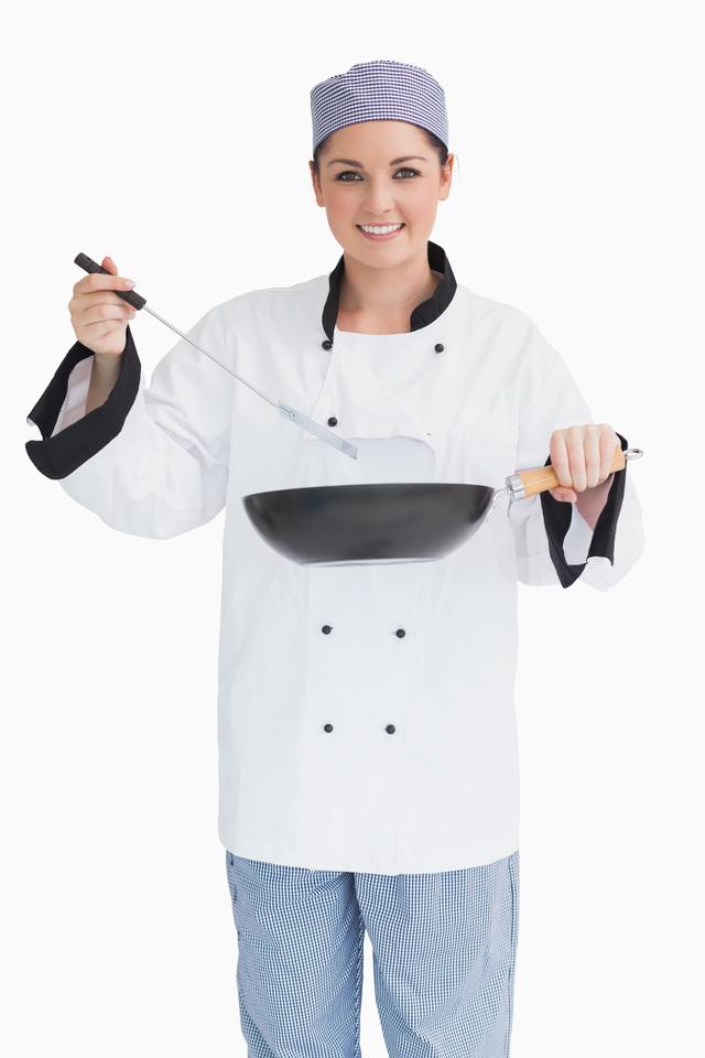 """Glad cook cooking with wok and spoon"" stock image"