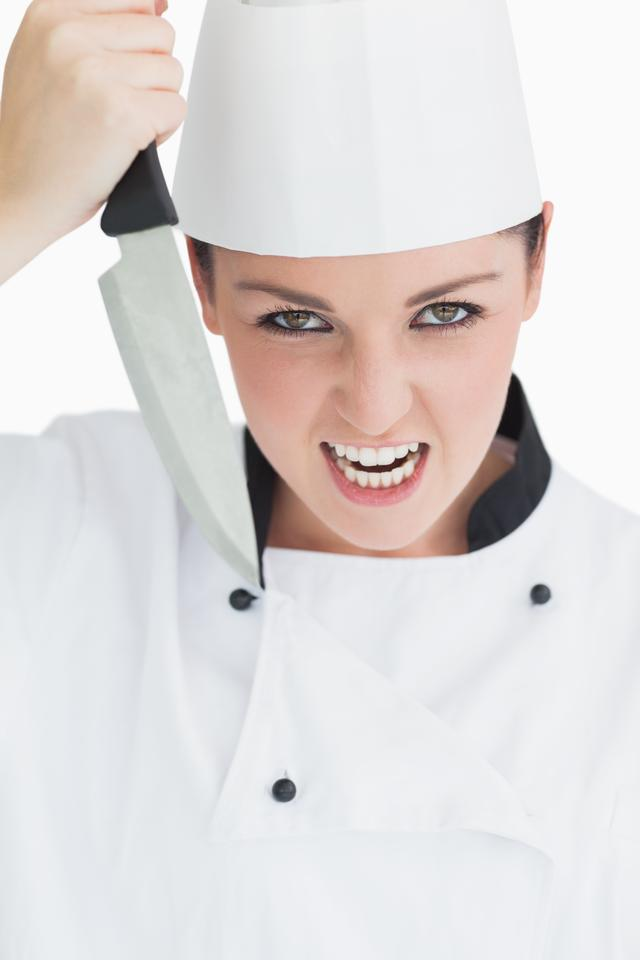 """""""Furious cook holding a knife"""" stock image"""