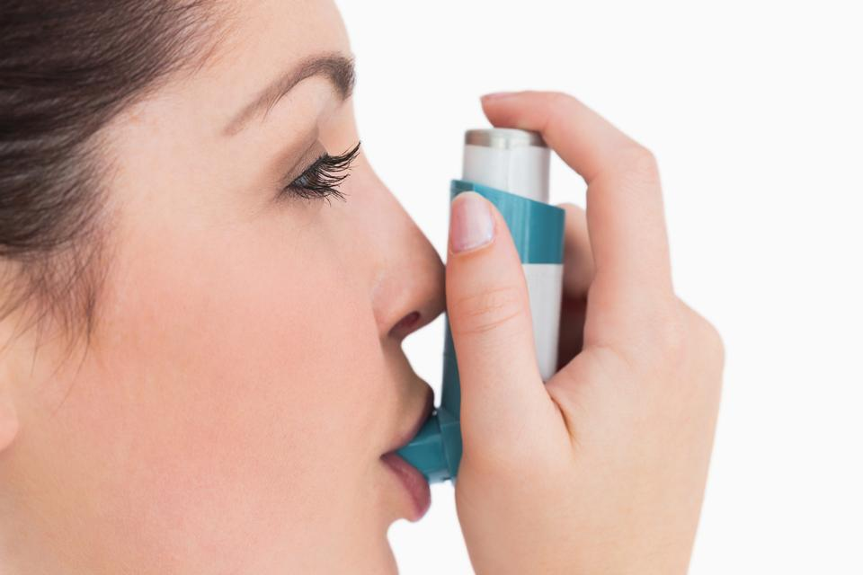 """""""Woman with an asthma inhaler"""" stock image"""
