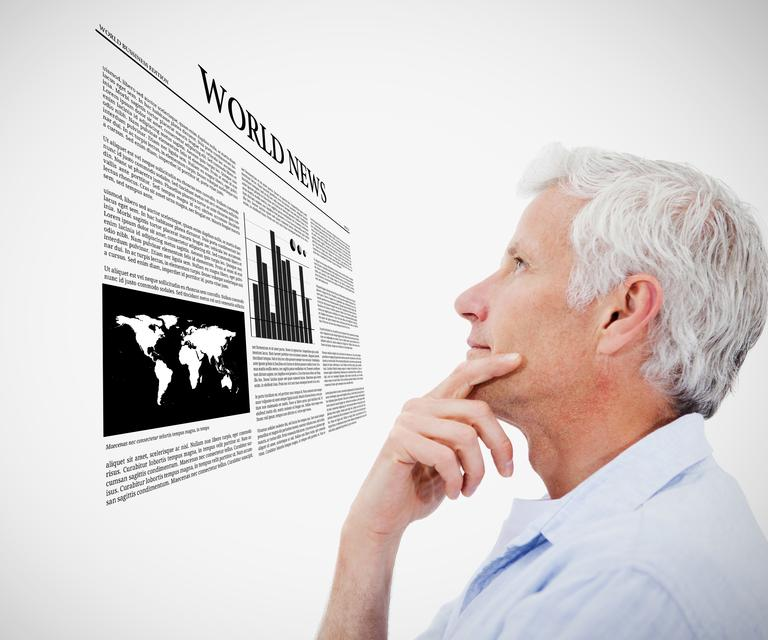 """Man reading holographic world news"" stock image"