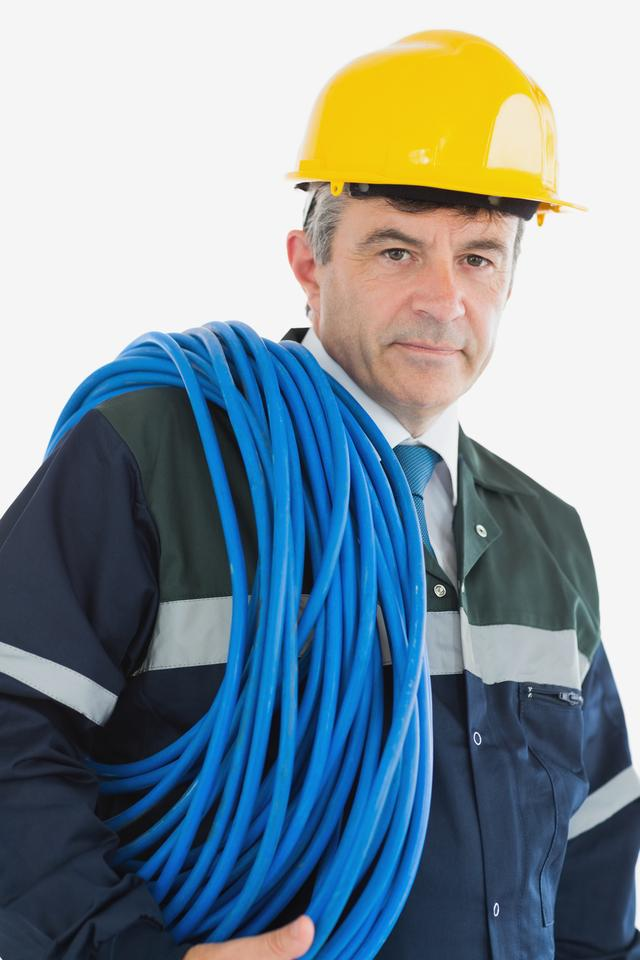 """Mature man wearing hardhat with cable"" stock image"