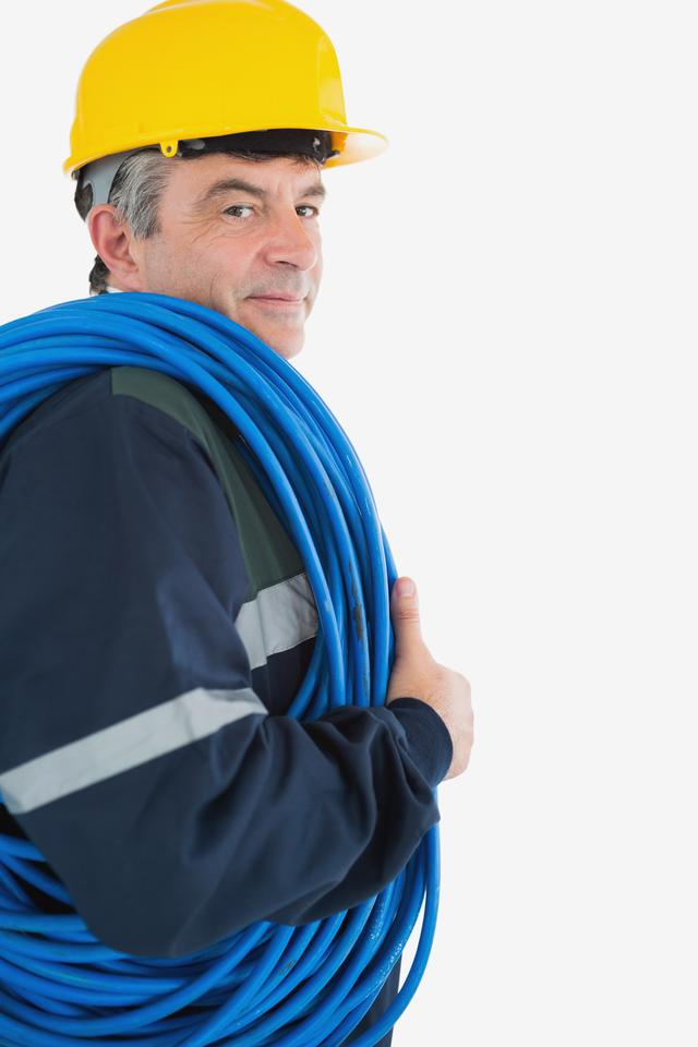 """Repairman wearing hardhat with cable"" stock image"