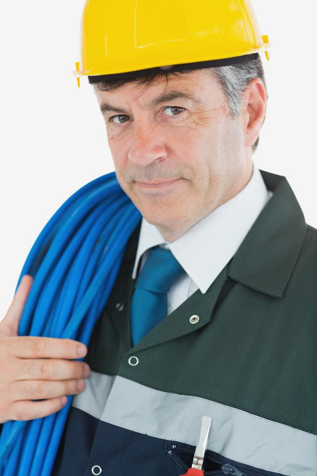 """Portrait of repairman with large wire and hardhat"" stock image"
